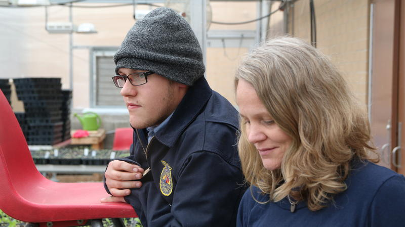 Colt Brogan and Crystal Snyder inside a greenhouse at Lincoln County High School