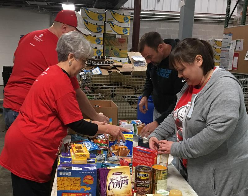Volunteers sort donations at Lexington-based God's Pantry.