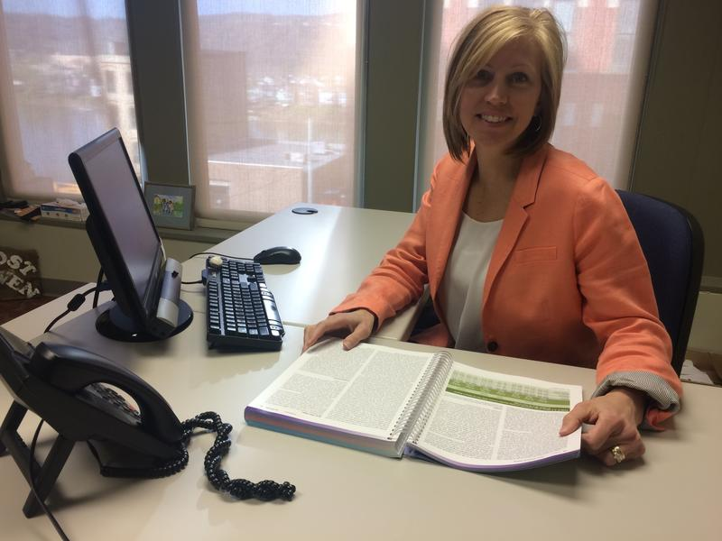 Carrie Abraham in her office at Wheeling Jesuit University