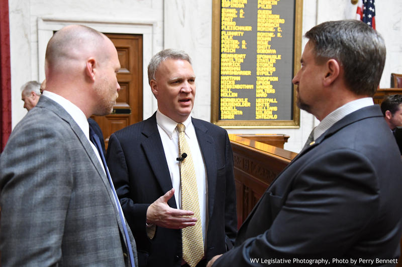 House Speaker Tim Armstead, center, speaks with Delegates Isaac Sponaugle, left, and Brent Boggs, right, on the House floor Thursday.