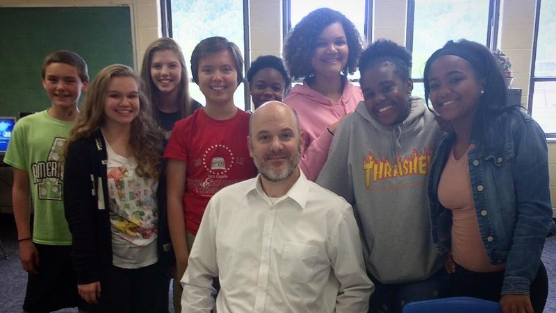 Matt Heusel, teacher at Wheeling Middle School, with his 8th grade writing class (L-R) Steven Wilson, Isabelle Bringman, Caroline Spencer, Jake Brozowski, Laniyah Westly, Mikhari Benjamin, Harmonie Jackson-Mayfield, and Laila Clark