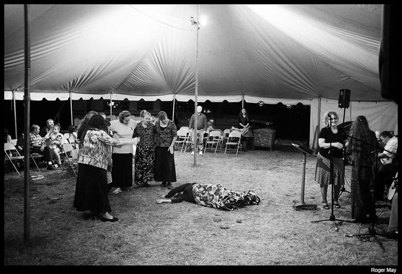 Ladies surround a sister who is slain in the spirit during a tent revival service in Goody, Kentucky, 19 July 2014.