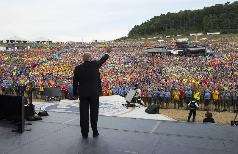 President Donald Trump waves to the crowd after speaking at the 2017 National Scout Jamboree in Glen Jean, W.Va.