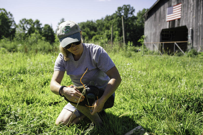 Crystal Snyder at her job with Refresh Appalachia, at a farm in Cabell County