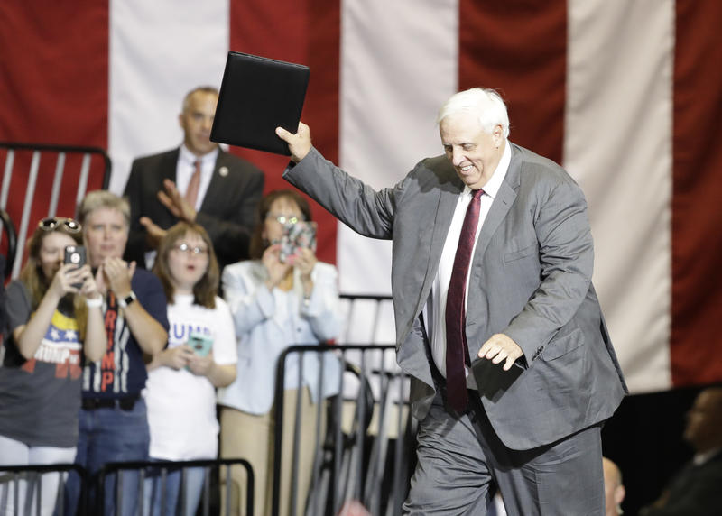 West Virginia Gov. Jim Justice walks to the podium during a rally for President Donald Trump Thursday, Aug. 3, 2017, in Huntington, W.Va.