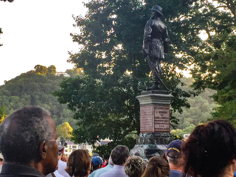 A crowd of about 80 people rallied at the W.Va. State Capitol to ask for the removal of a Confederate statue