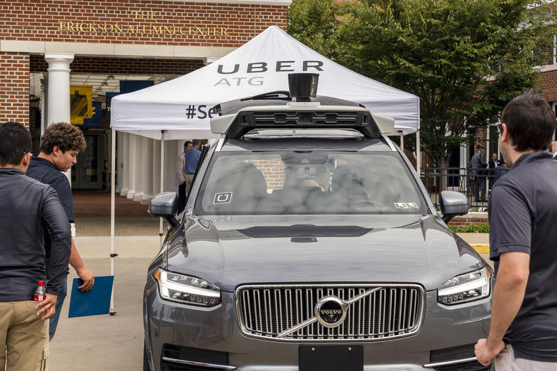 People take a look at an Uber driverless vehicle during a forum Wednesday, Sept. 20, 2017 at the WVU Erickson Alumni Center, in Morgantown, W.Va.
