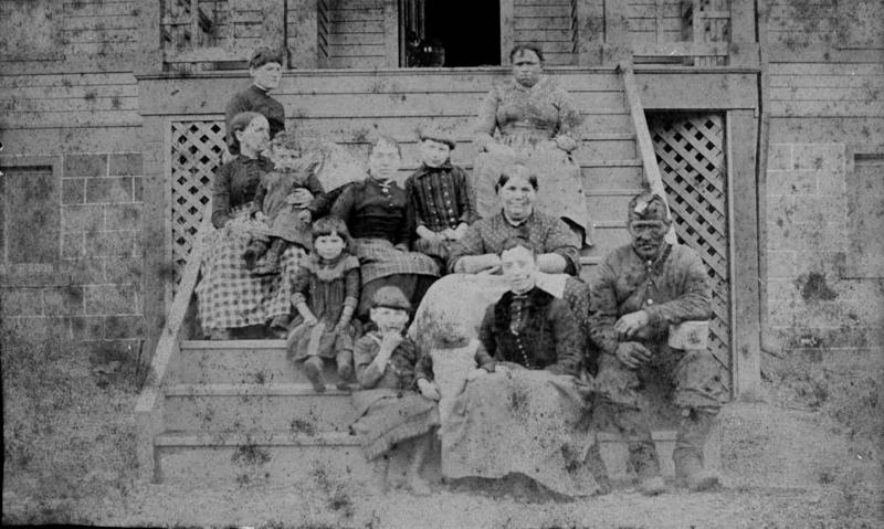 Miner with family in Beury, Fayette County, undated.