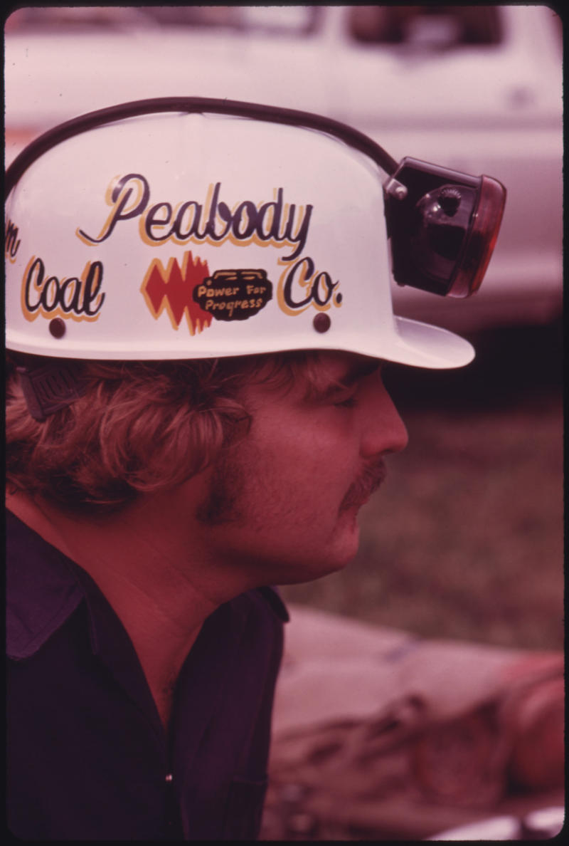 Closeup of a member of the Peabody Coal Company Team that is competing in the Kentucky State Mine Safety Contest at Benham near Cumberland, 1974.