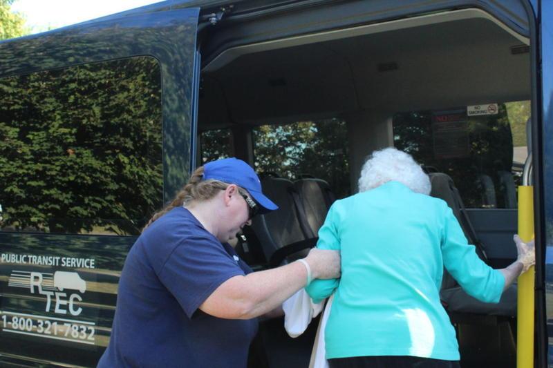 Mary Denny helps Thelma Daulton aboard.