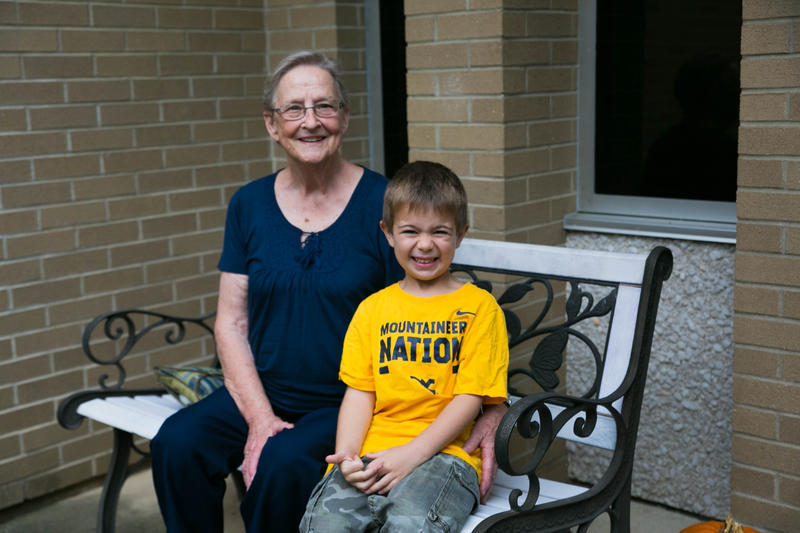 Jane Ann Grishaber and her adopted great-grandson Caydn outside of Kenna Elementary School in Charleston.