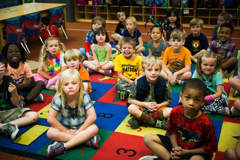 Caydn (yellow shirt, center) in his Kindergarten classroom at Kenna Elementary School