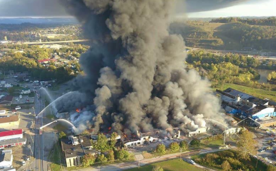 A fire burns at an industrial site in Parkersburg, W.Va.