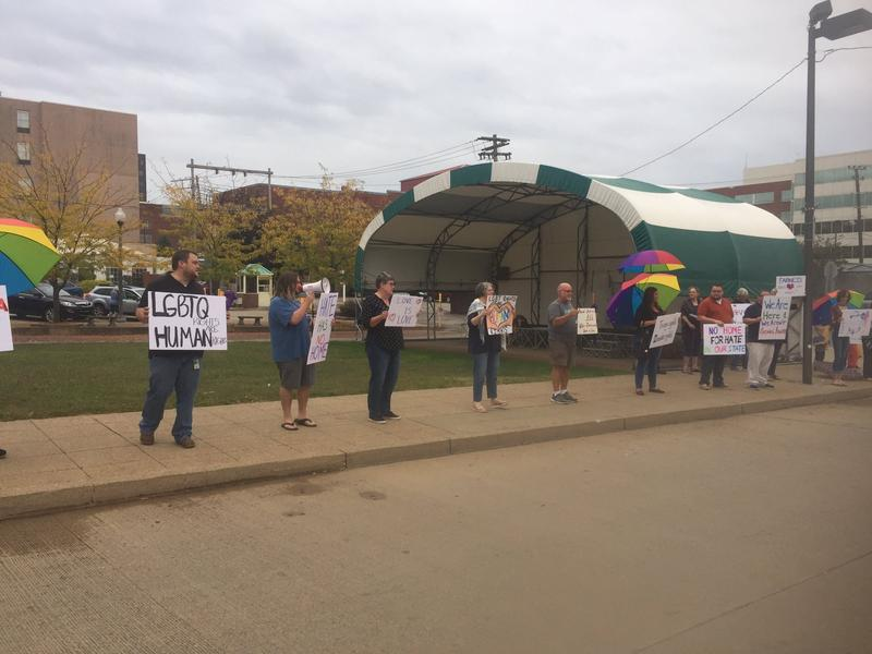 Members of Fairness PKB and other LGBTQ rights adovocates rally before a Parkersburg City Council meeting on September 12, 2017