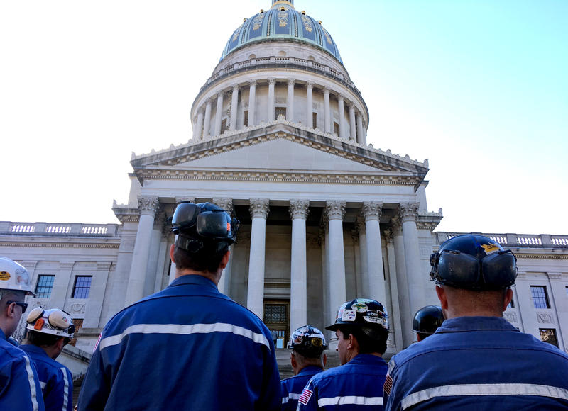 A group of coal miners listens to speakers at a pro-coal rally, Tuesday, Nov. 28, 2017, at the state Capitol in Charleston, W.Va.
