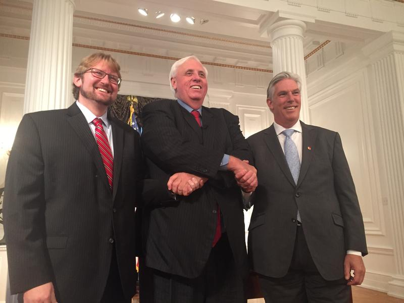 (Left to right) WVU Energy Institute director Dr. Brian Anderson, Governor Jim Justice and state Commerce Secretary Woody Thrasher pose for photos following a press conference about an $84 billion investment announced last week with China Energy.