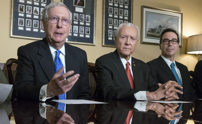 Majority Leader Mitch McConnell, R-Ky., Senate Finance Committee Chairman Orrin Hatch, R-Utah, and Treasury Secretary Steven Mnuchin, speak to reporters Nov. 9, 2017, on Capitol Hill in Washington.