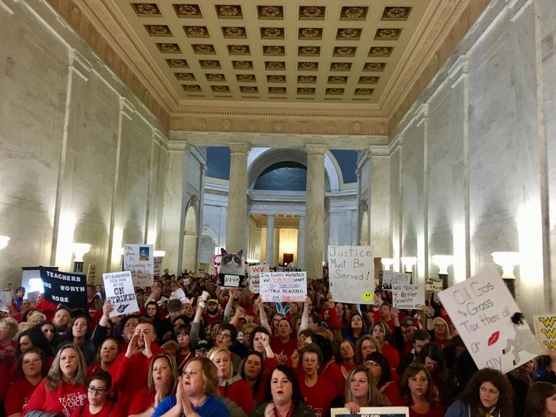 Thousands of teachers rally at the state Capitol in Charleston, W.Va., Thursday, Feb. 22, 2018. Teachers went on strike Thursday over pay and benefits.