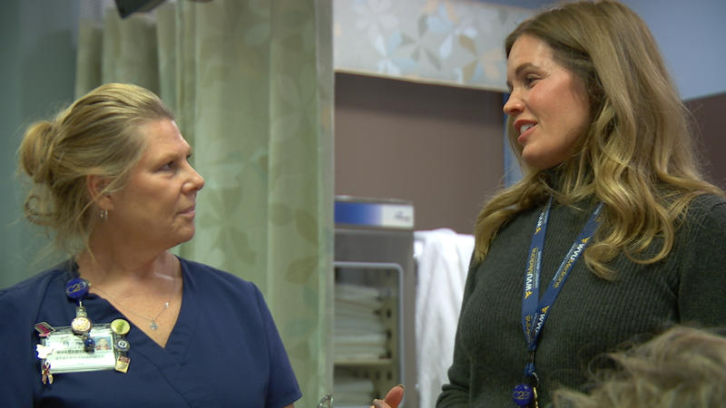 Samantha Richards (right), Vice President and Chief Nursing Officer for Patient Care Services, Berkeley and Jefferson Medical Centers speaking with a nurse at Berkeley Medical Center in Martinsburg.