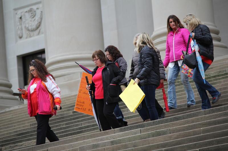 Teachers on the steps of the Capitol Thursday, Feb. 22, in Charleston, W.Va.