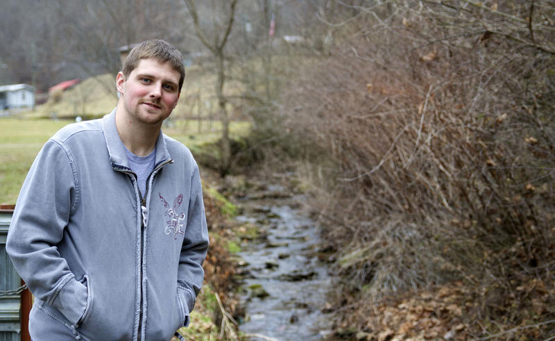 Jason Walker, one of the Cedar Creek residents who have accused Dynamic Energy of contamining their water, poses near a creek from which he draws water to flush his toliets.