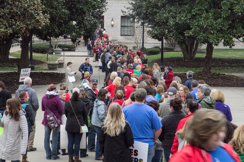 Teachers and support personnel line up to get into the Capitol Thursday, Feb. 22, in Charleston, W.Va.