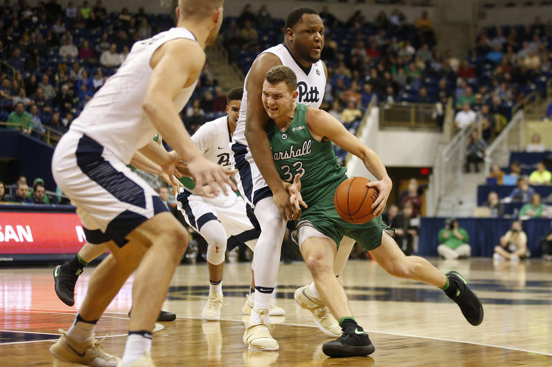 Marshall guard Jon Elmore (33) drives to the basket before being fouled by Pittsburgh center Rozelle Nix (25) during the first half of an NCAA college basketball game in Pittsburgh on Wednesday, Dec. 28, 2016.