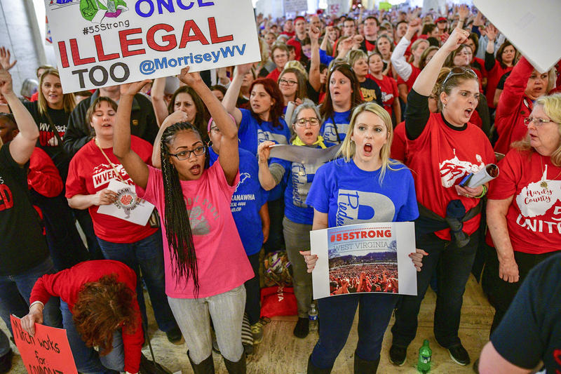 Teachers hold a rally outside the Senate Chambers in the West Virginia Capitol Monday, March. 5, 2018 in Charleston, W.V. Hundreds of teachers from 55 counties are on strike for pay raises and better health benefits.