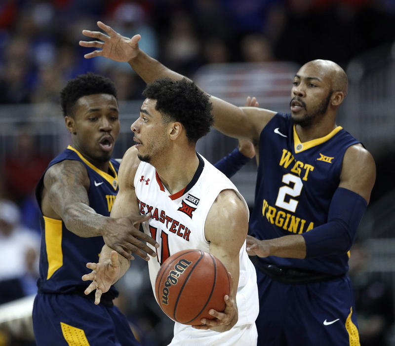 West Virginia's Daxter Miles Jr., left, and Jevon Carter (2) pressure Texas Tech's Zach Smith during the first half of an NCAA college basketball game in the Big 12 men's tournament Friday, March 9, 2018, in Kansas City, Mo.