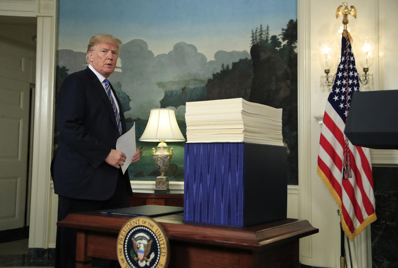 President Donald Trump arrives in the Diplomatic Room of the White House in Washington, Friday, March 23, 2018, to speak about the $1.3 trillion spending bill which he signed earlier in the day.