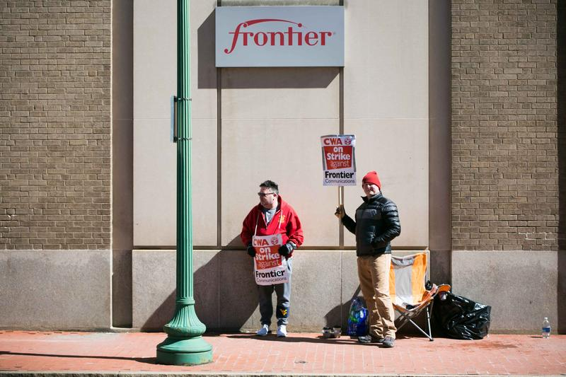 Frontier employees Gene Hall and Benjamin Norman, CWA union members on strike outside Frontier building in downtown Charleston.