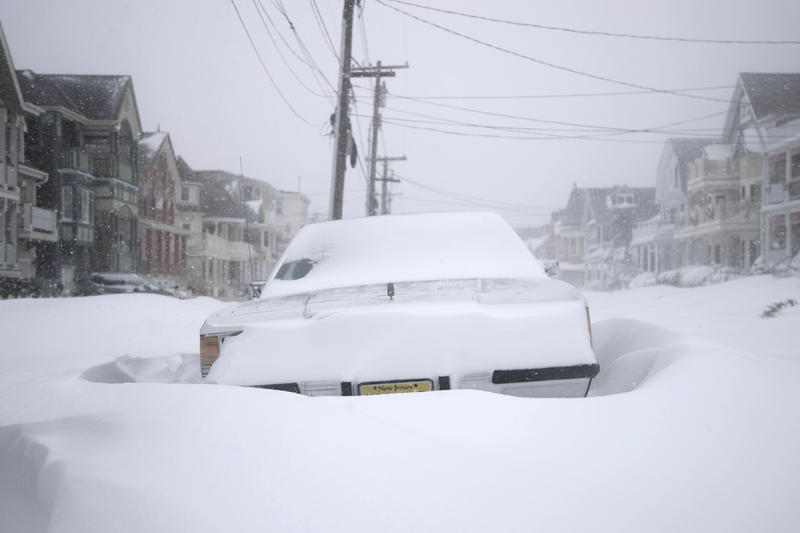A vehicle parked on Abbott Avenue is engulfed by snowdrifts during a snowstorm that hit the New Jersey Shore, Thursday, Jan. 4, 2018, in Ocean Grove, N.J. A massive winter storm swept from the Carolinas to Maine on Thursday.