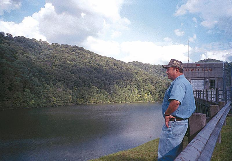 Jim Powers stands on top of Dewey Dam, Monday, Aug. 20, 2001, near Van Lear, Ky.