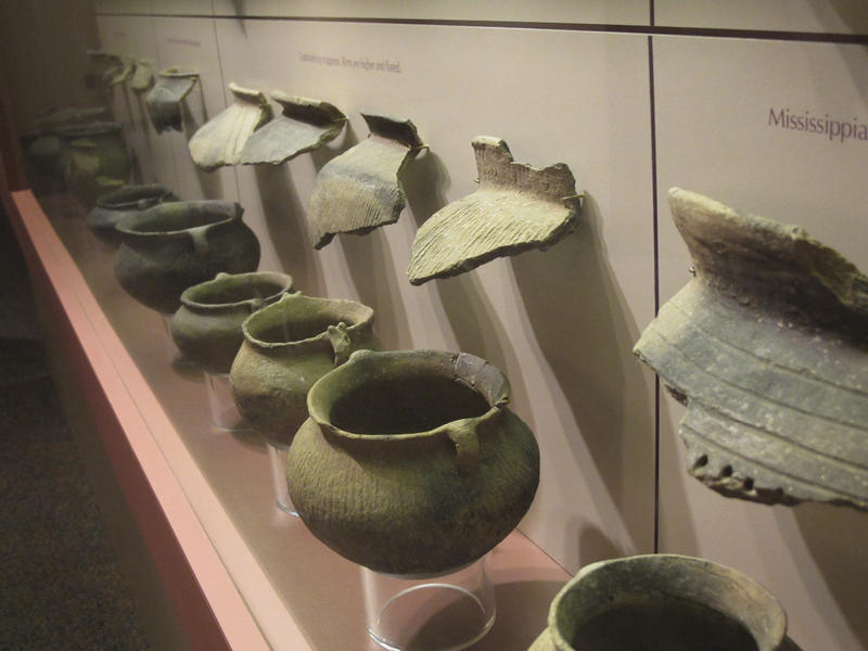 In this May 7, 2012 photo, displays at the Dickson Mounds State Museum near Lewistown, Ill., show pots and other American Indian artifacts found at and around the museum site.