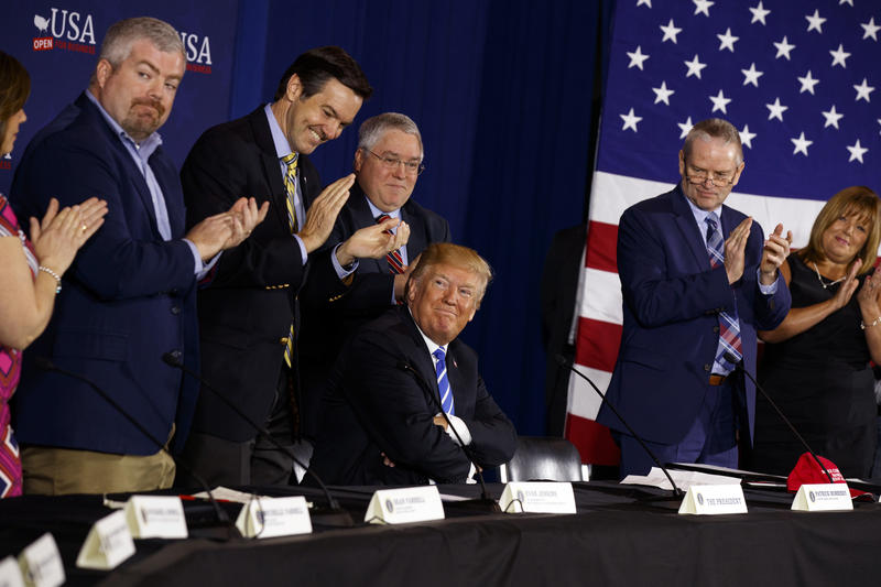 President Donald Trump smiles as people applaud him during a roundtable discussion on tax policy in White Sulphur Springs, W.Va. on Thursday, April 5, 2018.