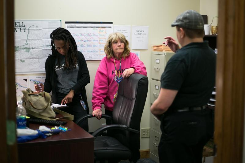 A quick response team talks about their upcoming cases for the day. Frome left to right, Larrecsa Cox, Sue Howland and Chris Trembley
