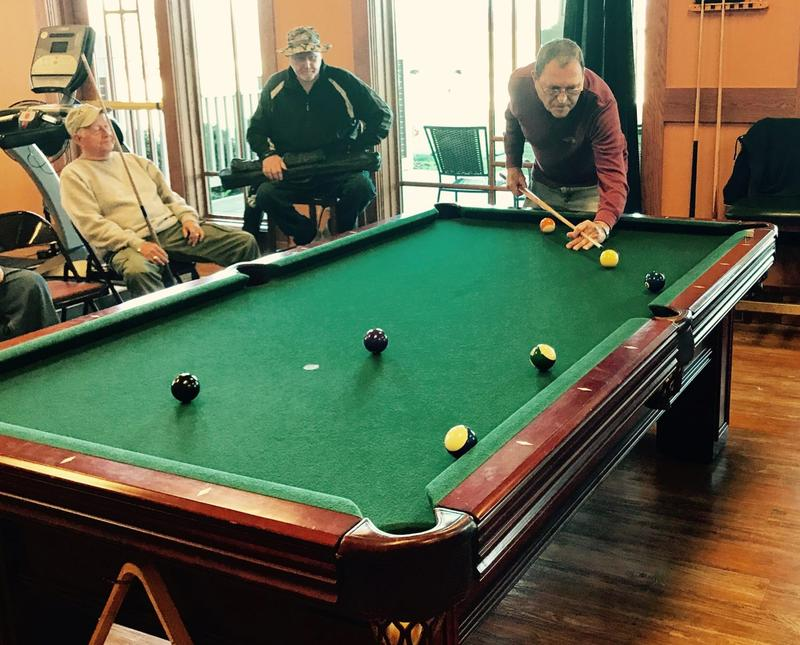 Billy Hobby takes a shot at a senior center pool table.