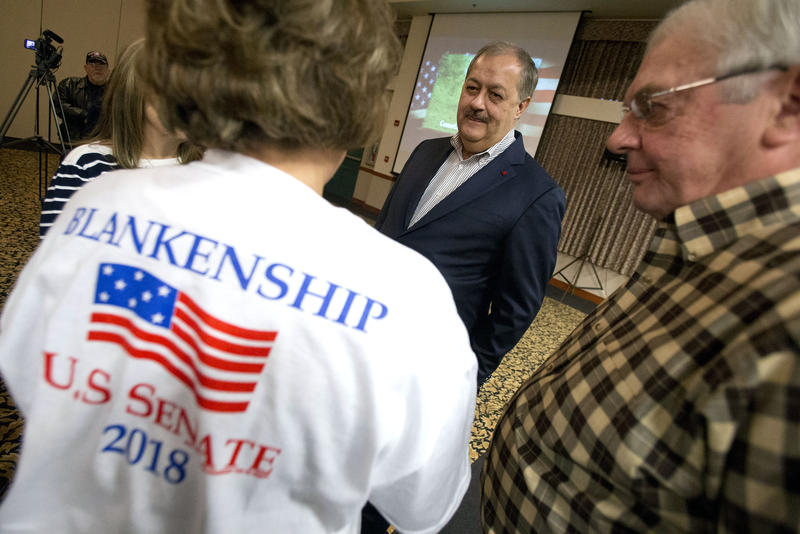 Supporters talk with former Massey CEO and West Virginia Republican Senatorial candidate, Don Blankenship, center, prior to a town hall to kick off his campaign in Logan, W.Va., Thursday, Jan. 18, 2018.