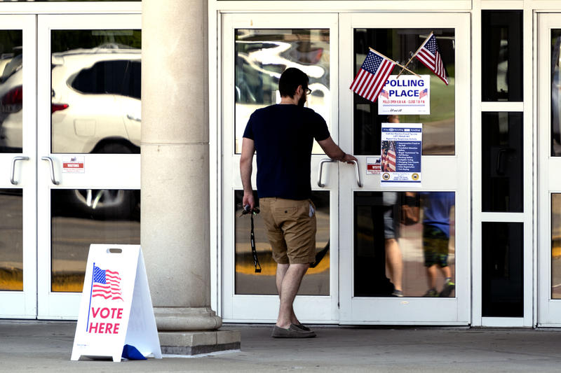 A voter heads to the polls at Morgantown High School on Tuesday, May 8, 2018.