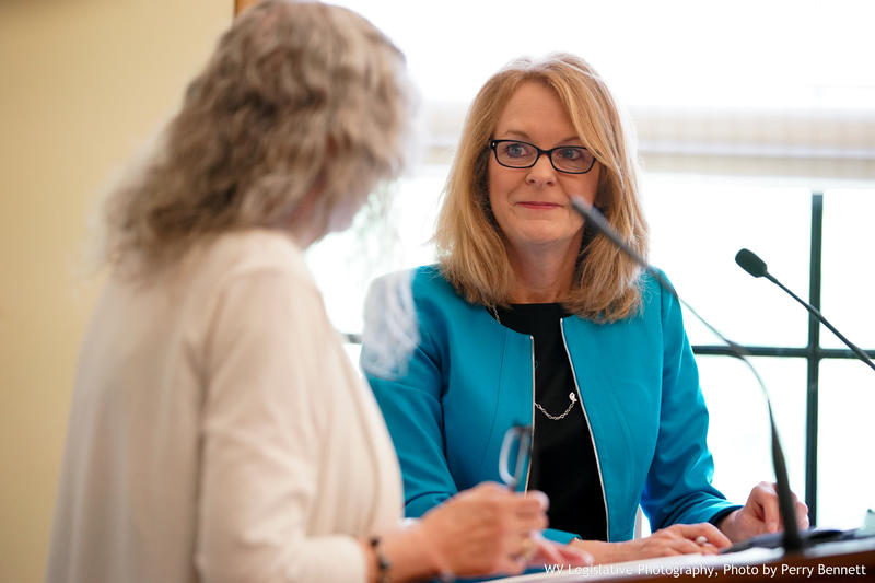 Helen Matheny (right) looks at Del. Ruth Rowan during an interim meeting of the Select Committee on PEIA, Seniors and Long Term Care on May 20, 2018.