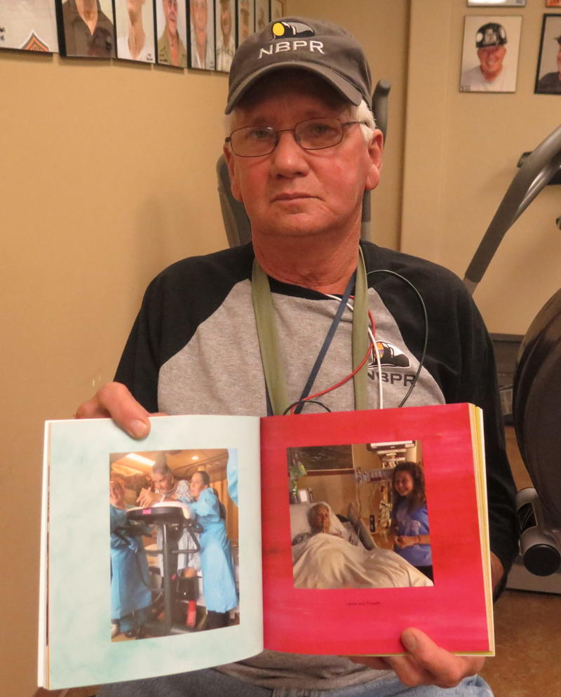 Jerry Helton shows a scrapbook of photos from his surgery.