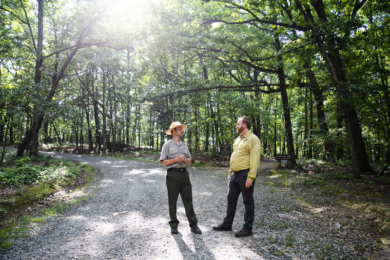 Sean Higgins (left) and Jason Urroz talk about Kids in the Park at the Occoneechee Mountain State Natural Area