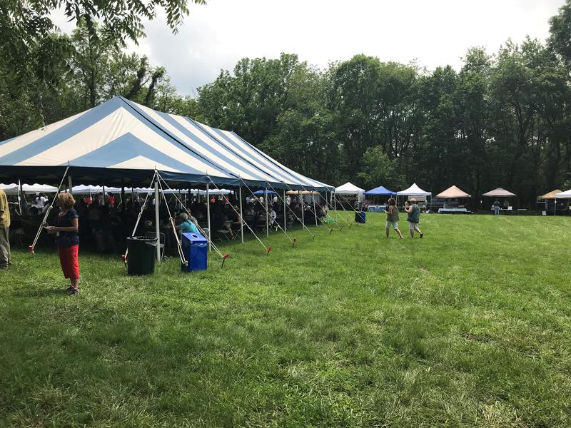 A dozen smaller tents house both vendors and volunteers during the Wine and Jazz Festival at Happy Retreat. A larger tent offers tables and chairs for festival-attendees.