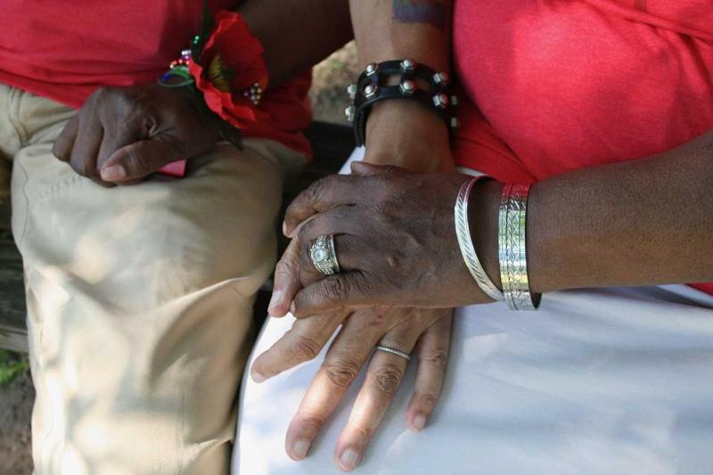 Bernice Miller and Jacqui Lewis, Huntington residents, hold hands at the Pride Picnic in Huntington last month.
