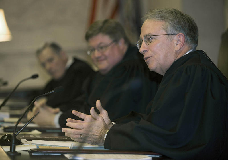 In this Thursday, Dec. 18, 2008 file photo, Justice Menis Ketchum, right, takes his place on the bench in the West Virginia Supreme Court chambers at the state capital in Charleston, W.Va.