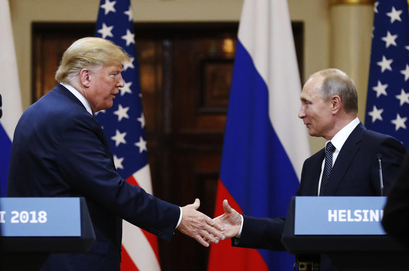 U.S. President Donald Trump shakes hand with Russian President Vladimir Putin at the end of the press conference after their meeting at the Presidential Palace in Helsinki, Finland, Monday, July 16, 2018.