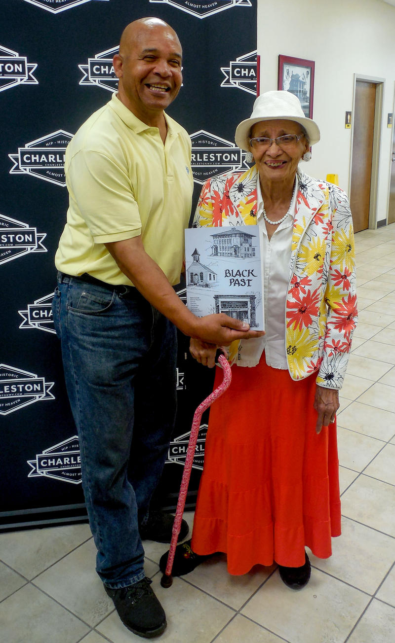 Anthony Kinzer, executive director of the West Virginia Center for African-American Art & Culture, and Anna Gilmer, co-author of the 1989 book Black Past celebrate the reprinting of the historic book about Charleston's African American history.