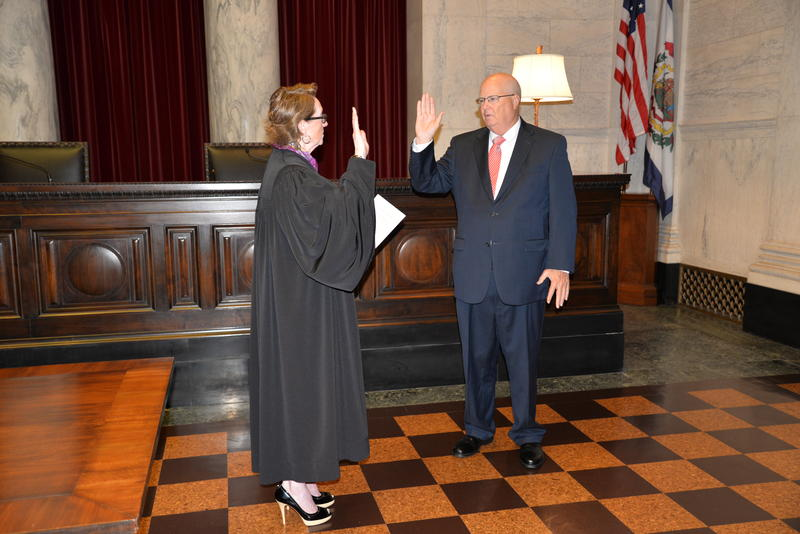 Supreme Court Justice Robin Jean Davis, left, delivers the oath of office to  Judge Paul Farrell in the Supreme Court Chamber at 10:30 a.m. Friday, August 10, 2018. Chief Justice Margaret Workman appointe Farrell to serve on the court.