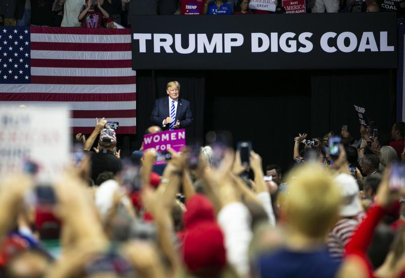 President Donald Trump address a crowd at the Charleston Civic Center in Charleston, W.Va. on Aug. 21, 2018.