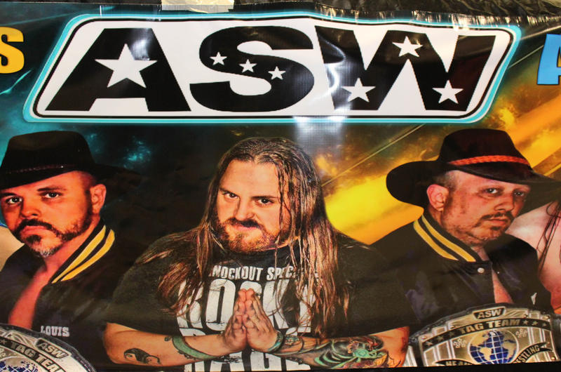 Poster at All Star Wrestling in Madison. Rocky is the one in the middle